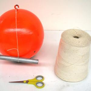 Make a string with loops on both ends.  Loop one end over the hook in the bowling ball, and insert the handle into the other end.  Pull up slowly and you will be able to lift the bowling ball.  Jerk quickly and the string will break.  This is a simpler version of 1F20.10.   conbot.gif (53 bytes)