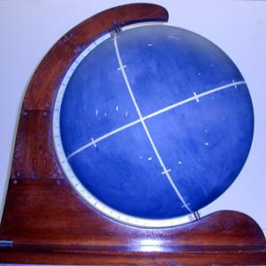 Use bright chalk to draw lines and coordinates on the chalk globe.  String may be used to show that a straight line is not the shortest distance on the curved surface of the globe.
