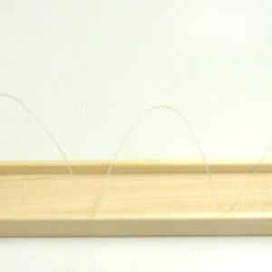 Try to make sure that the weight is not swinging when you start the toy.  The toy should walk towards the end of the table and stop at the edge when the vector (string and weight) points straight down.