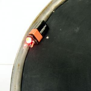 In a darkened room you will see that in the reference frame of the bicycle wheel, the LED moves in a circle.  However, if you role the wheel along the lecture bench, you will see that the LED describes a cycloid when looked at from the benches reference frame.