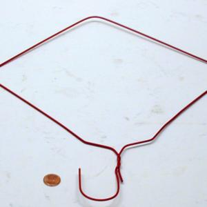 Balance the penny on the end of the hook on the hanger.  Gently, rotate the hanger until you can go full circle.  Note that the penny is held onto the end of the hook by the rotational force applied.