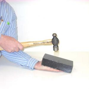Place the lead brick on your hand.  Hit the brick hard with the hammer.  You will be undamaged.