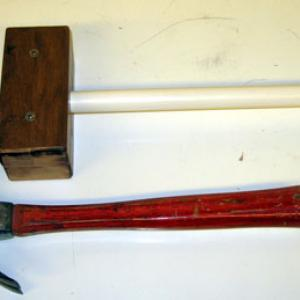 This demo is used to show that you don't tighten a hammer head by hitting it onto the handle, but rather by placing the head on the handle and then slamming the other end of the handle onto the table.  Doing this with the PVC and movable hammer head will show that the hammer head travels downward onto the handle.  If you try to pound the hammer head onto the PVC handle, the hammer head will actually move off the handle.