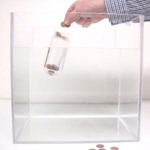 Place some pennies in the bottle.  Then place the bottle in the water tank and observe that it will float in an upright position.   Start placing pennies into the ring at the top of the bottle and observe that when the center of gravity becomes too high the bottle will tip over.