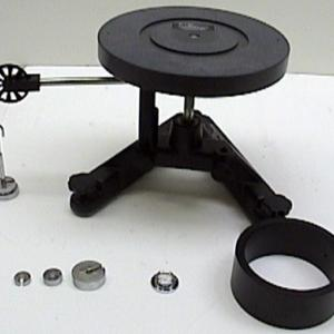 Place the disk on the shaft of the rotational support.  As the masses are allowed to fall the rotational inertia of the disk can be calculated.  The ring can be added to the top of the disk which adds more mass and therefore changes the value of the rotational inertia.
