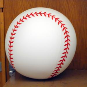 Take the weather balloon and draw the stitches of a baseball on it. Fill the balloon with part air and part helium to the desired diameter, so that the balloon has neutral buoyancy.
